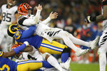 Cincinnati Bengals quarterback Andy Dalton, top, is sacked by Los Angeles Rams defensive tackle Aaron Donald during the second half of an NFL football game, Sunday, Oct. 27, 2019, at Wembley Stadium in London. (AP Photo/Tim Ireland)