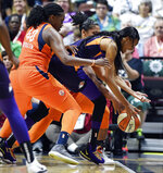 Connecticut guard Shekinna Stricklen, left, and forward Alyssa Thomas, back, trap Phoenix Mercury forward Dewanna Bonner along the sideline during a WNBA basketball game Friday, July 12, 2019, in Uncasville, Conn. (Sean D. Elliot/The Day via AP)