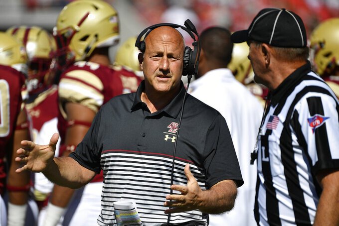 Boston College head coach Steve Addazio argues a call with a game official during the first half of an NCAA college football game against Louisville in Louisville, Ky., Saturday, Oct. 5, 2019. (AP Photo/Timothy D. Easley)