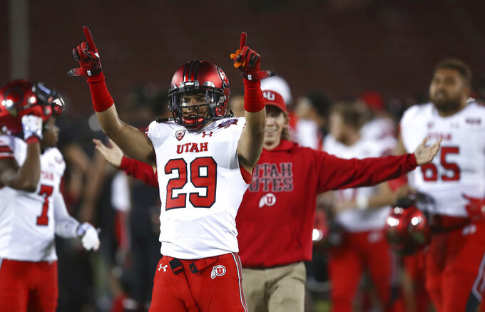 Utah's Tre Strong (29) celebrates at the end of an NCAA college football game against Stanford on Saturday, Oct. 6, 2018, in Stanford, Calif. Utah won 40-21. (AP Photo/Ben Margot)
