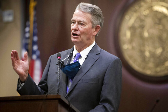 """FILE - In this Oct. 1, 2020, file photo, Idaho Gov. Brad Little gestures during a press conference at the Statehouse in Boise, Idaho. Gov. Little has issued an executive order repealing a mask-mandate prohibition put in place while he was out of the state by the lieutenant governor, describing her actions as a tyrannical abuse of power and an """"irresponsible, self-serving political stunt."""" The Republican governor on Friday, May 28, 2021, rescinded Republican Lt. Gov. Janice McGeachin's executive action taken Thursday. (Darin Oswald/Idaho Statesman via AP, File)"""