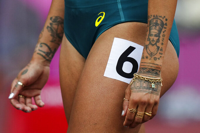 Morgan Mitchell, of Australia, prepares to start in her heat of the women's 800-meters at the 2020 Summer Olympics, Friday, July 30, 2021, in Tokyo. (AP Photo/Matthias Schrader)