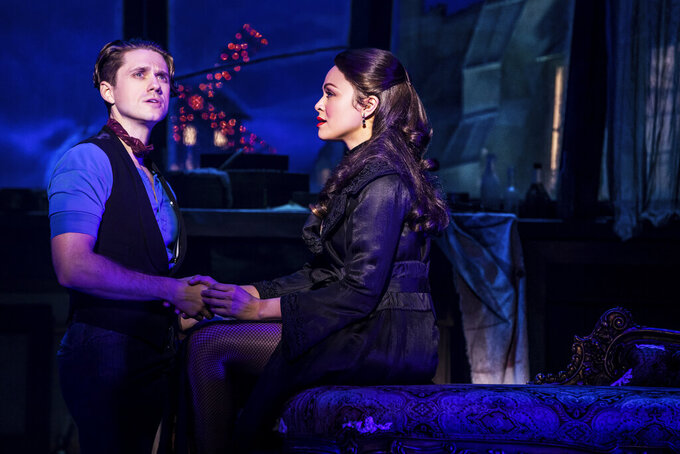 """Aaron Tveit, left, appears with Karen Olivo during a performance of """"Moulin Rouge! The Musical,"""" in New York. Tveit was the only actor nominated for a Tony in the category of best leading actor in a musical for his role. (Matthew Murphy/Boneau/Bryan-Brown via AP)"""