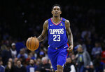"""FILE - In this Feb. 11, 2020, file photo, Los Angeles Clippers' Lou Williams brings the ball up during the team's NBA basketball game against the Philadelphia 76ers in Philadelphia. Clippers coach Doc Rivers says Williams is expected to join the team for the NBA's restart in Florida. Williams has described himself as """"50-50"""" on whether he would finish out the pandemic-interrupted season because he didn't want to distract from the ongoing push for social justice in the wake of George Floyd's death while in police custody. (AP Photo/Matt Slocum, File)"""