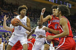 Washington forward Jaden McDaniels, left, looks to pass the ball as Arizona forward Zeke Nnaji, right, and guard Josh Green, second from right, defend during the first half of an NCAA college basketball game Thursday, Jan. 30, 2020, in Seattle. (AP Photo/Ted S. Warren)