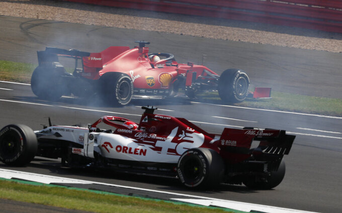 Ferrari driver Sebastian Vettel of Germany, top, spins off the track during the 70th Anniversary Formula One Grand Prix at the Silverstone circuit, Silverstone, England, Sunday, Aug. 9, 2020. (AP Photo/Frank Augstein, Pool)