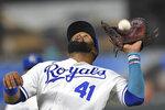Kansas City Royals first baseman Carlos Santana catches a pop foul by Cleveland Indians' Jose Ramirez during the ninth inning of a baseball game Tuesday, Aug. 31, 2021, in Kansas City, Mo. (AP Photo/Reed Hoffmann)