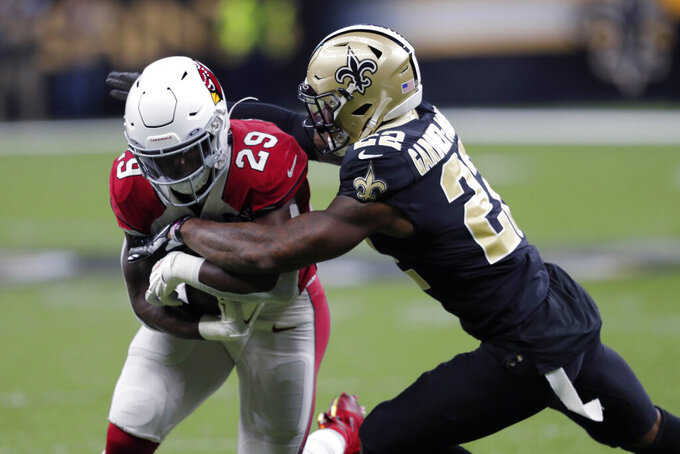 New Orleans Saints defensive back Chauncey Gardner-Johnson (22) tackles Arizona Cardinals running back Chase Edmonds (29) in the first half of an NFL football game in New Orleans, Sunday, Oct. 27, 2019. (AP Photo/Bill Feig)