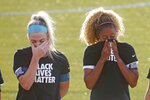 Chicago Red Stars' Julie Ertz, left, and Casey Short, cry after players for their knelt during the national anthem before an NWSL Challenge Cup soccer match against the Washington Spirit at Zions Bank Stadium, Saturday, June 27, 2020, in Herriman, Utah. (AP Photo/Rick Bowmer)