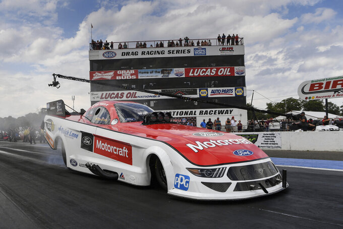 In this photo provided by the NHRA, Funny Car veteran Bob Tasca III cruises in his Mustang to seed himself in the provisional No. 1 spot on Friday, Aug. 20, 2021, at the Lucas Oil NHRA Nationals in Brainerd, Minn. (Jerry Foss/NHRA via AP)