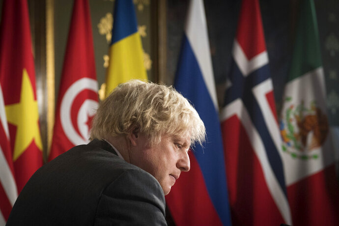 Britain's Prime Minister Boris Johnson chairs a session of the UN Security Council on climate and security at the Foreign, Commonwealth and Development Office in London, Tuesday, Feb. 23, 2021. (Stefan Rousseau/Pool Photo via AP)