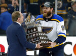 NHL Commissioner Gary Bettman presentes St. Louis Blues' Ryan O'Reilly with the Conn Smythe trophy after the Blues' win over the Boston Bruins in Game 7 of the NHL hockey Stanley Cup Final, Wednesday, June 12, 2019, in Boston. (AP Photo/Michael Dwyer)