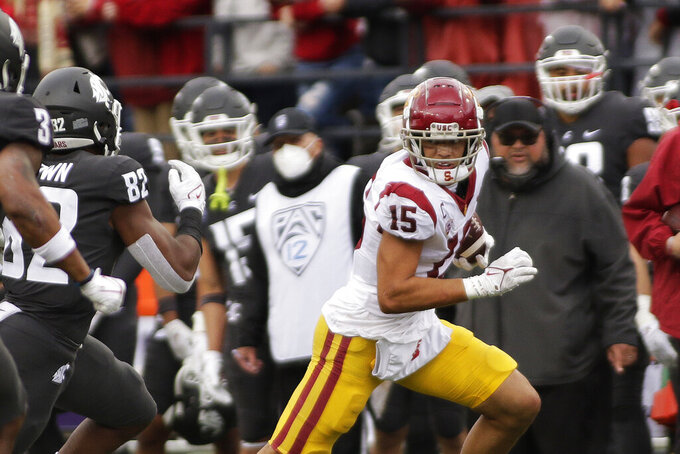 Southern California wide receiver Drake London (15) carries the ball while pursued by Washington State linebacker Travion Brown (82) during the second half of an NCAA college football game, Saturday, Sept. 18, 2021, in Pullman, Wash. Southern California won 45-14. (AP Photo/Young Kwak)