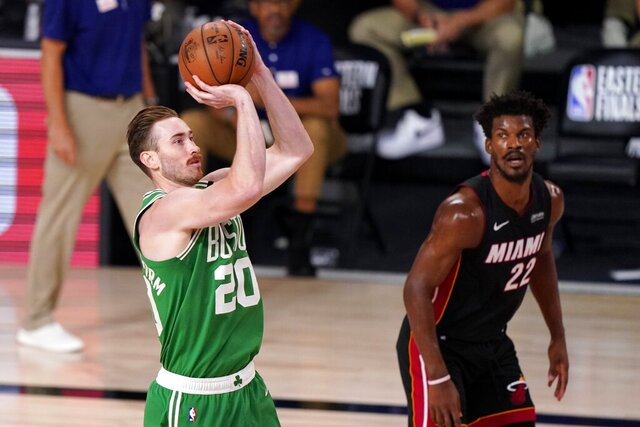 Boston Celtics forward Gordon Hayward (20) takes a shot as Miami Heat's Jimmy Butler (22) looks on during the second half of Game 4 of an NBA basketball Eastern Conference final, Wednesday, Sept. 23, 2020, in Lake Buena Vista, Fla. (AP Photo/Mark J. Terrill)