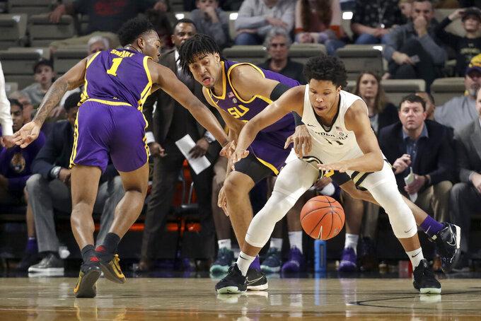 LSU's Javonte Smart (1) and Trendon Watford, center, defend against Vanderbilt's Braelee Albert (11) in the first half of an NCAA college basketball game Wednesday, Feb. 5, 2020, in Nashville, Tenn. (AP Photo/Mark Humphrey)