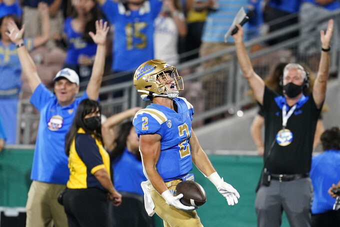 UCLA wide receiver Kyle Philips scores against LSU during the second half of an NCAA college football game Saturday, Sept. 4, 2021, in Pasadena, Calif. (AP Photo/Marcio Jose Sanchez)