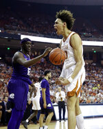 Texas forward Jaxson Hayes, right, reacts after scoring against TCU during the second half of an NCAA college basketball game, Saturday, March 9, 2019, in Austin, Texas. (AP Photo/Eric Gay)
