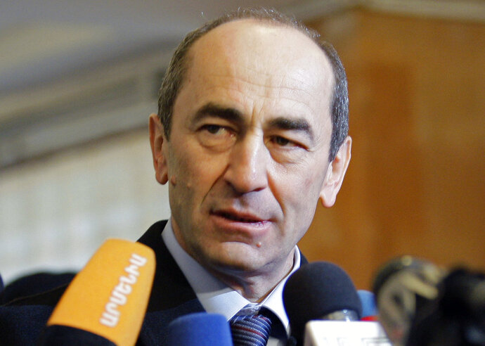 FILE- In this file photo dated Tuesday, Feb. 19, 2008, Armenian President Robert Kocharian talks to the media at a polling station in Yerevan. Defense lawyer Aik Alumian said Friday Sept. 14, 2018, that a wiretapped conversation shows that charges against former president Kocharian are politically driven, and show Kocharian's rights were violated. (AP Photo/Misha Japaridze, FILE)
