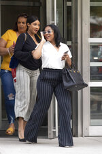 Azriel Clary, right, and Joycelyn Savage, two women who lived in Chicago with R&B singer R. Kelly, leave at Brooklyn federal court following his arraignment, Friday, Aug. 2, 2019 in New York. Kelly pleaded not guilty Friday to federal charges he sexually abused women and girls. The 52-year-old Kelly was denied bail in a Brooklyn courtroom packed with his supporters.  (AP Photo/Mark Lennihan)