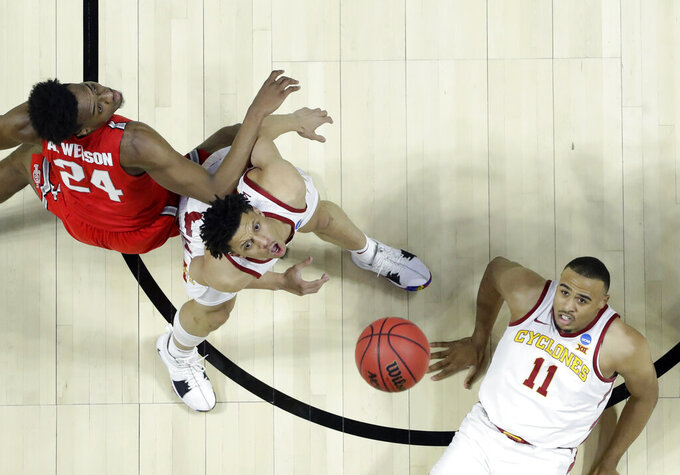 Iowa State's Talen Horton-Tucker (11) and Lindell Wigginton watch a rebound alongside Ohio State's Andre Wesson (24) during the first half of a first round men's college basketball game in the NCAA Tournament Friday, March 22, 2019, in Tulsa, Okla. (AP Photo/Jeff Roberson)