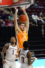 Tennessee forward John Fulkerson (10) dunks the ball over Texas A&M guard Jay Jay Chandler (0) during the first half of an NCAA college basketball game Saturday, Jan. 9, 2021, in College Station, Texas. (AP Photo/Sam Craft)
