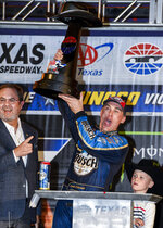 Kevin Harvick celebrates with the trophy in Victory Lane after winning a NASCAR Cup Series auto race at Texas Motor Speedway, Sunday, Nov. 3, 2019, in Fort Worth, Texas. (AP Photo/Larry Papke)