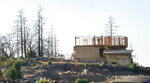 FILE - In this Tuesday, Nov. 5, 2019, file photo, a new home construction project sits on a hilltop in Santa Rosa, Calif. California state and local officials are incentivizing rebuilding in areas destroyed by wildfires at a time when people should be redirected away from those areas if the state wants to reduce the economic and human impact of increasingly destructive wildfires, according to a report published Thursday, June 10, 2021. (AP Photo/Lacy Atkins, File)