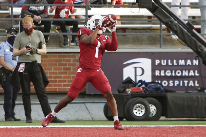 Washington State wide receiver Travell Harris catches a pass for a touchdown during the second half of an NCAA college football game against Portland State, Saturday, Sept. 11, 2021, in Pullman, Wash. (AP Photo/Young Kwak)