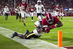 Southern Miss linebacker Santrell Latham (6) just keeps Alabama running back Roydell Williams (23) out of the end zone on a long run during the first half of an NCAA college football game, Saturday, Sept. 25, 2021, in Tuscaloosa, Ala. (AP Photo/Vasha Hunt)