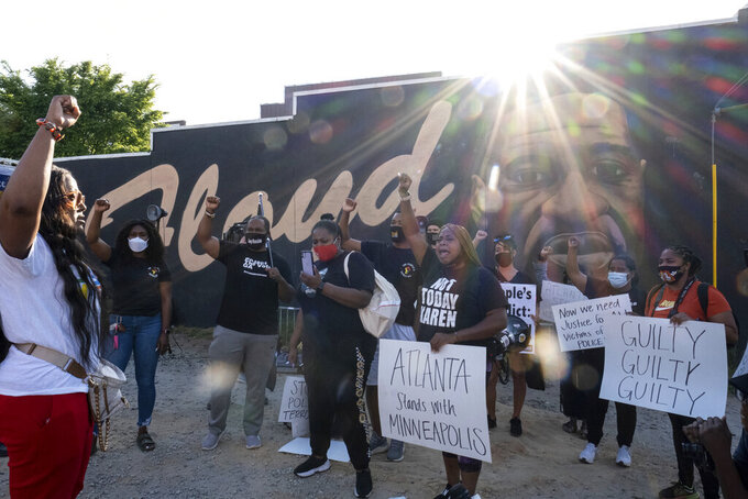People gather before a march in Atlanta, Tuesday, April 20, 2021, after former Minneapolis police Officer Derek Chauvin was found guilty on all counts in the death of George Floyd. (AP Photo/Ben Gray)