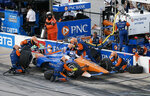 Scott Dixon gets fuel and tires during the IndyCar auto race at Texas Motor Speedway, Saturday, June 8, 2019, in Fort Worth, Texas. (AP Photo/Brandon Wade)