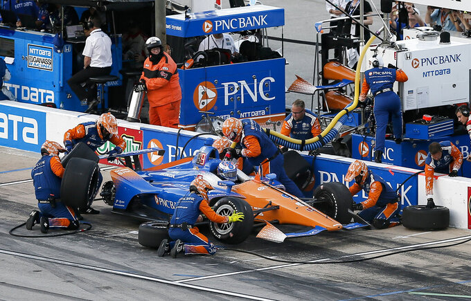 The Latest: Newgarden gets 1st Texas win, 3rd of season