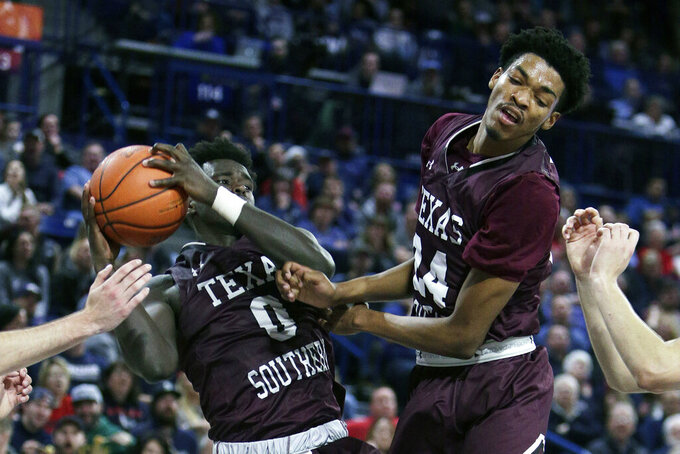 Texas Southern forward Yahuza Rasas (0) grabs a rebound in front of forward John Walker III (24) during the second half of an NCAA college basketball game against Gonzaga in Spokane, Wash., Wednesday, Dec. 4, 2019. Gonzaga won 101-62. (AP Photo/Young Kwak)
