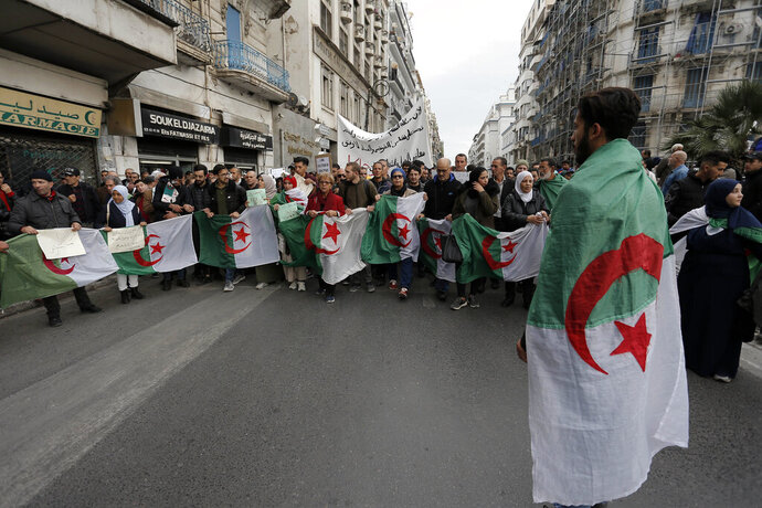 Algerian students take to the streets in the capital Algiers to reject the presidential elections and protest against the government, in Algiers, Algeria, Tuesday, Dec. 17, 2019. Algeria's Constitutional Council has confirmed Abdelkader Tebboune as the new president of Africa's largest country for the next five years — despite mass protests challenging his election. (AP Photo/Toufik Doudou)