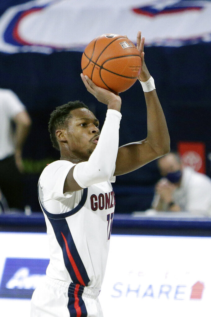 Gonzaga guard Joel Ayayi shoots during the first half of an NCAA college basketball game against Dixie State in Spokane, Wash., Tuesday, Dec. 29, 2020. (AP Photo/Young Kwak)