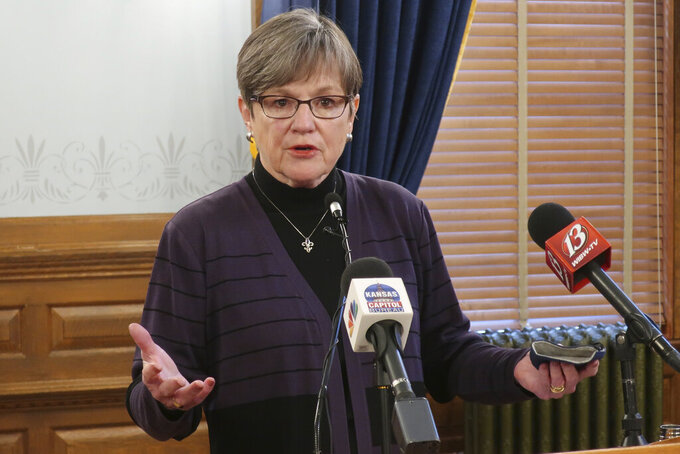 Kansas Gov. Laura Kelly answers questions during a news conference, Wednesday, Jan. 13, 2021, at the Statehouse in Topeka, Kan. The Democratic governor is dismissing criticism of her budget proposals from Republican legislators as an expected negotiating tactic. (AP Photo/John Hanna)