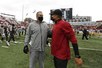 Washington State head coach Nick Rolovich, left, and Southern California interim head coach Donte Williams speak on the field after an NCAA college football game, Saturday, Sept. 18, 2021, in Pullman, Wash. Southern California won 45-14. (AP Photo/Young Kwak)