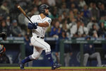 Seattle Mariners' Abraham Toro watches his grand slam off Houston Astros relief pitcher Kendall Graveman during the eighth inning of a baseball game Tuesday, Aug. 31, 2021, in Seattle. (AP Photo/Ted S. Warren)