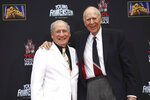 FILE - In this Sept. 8, 2014 file photo, Mel Brooks, left, stands with Carl Reiner during Brooks' hand and footprint ceremony on the 40th anniversary of the movie