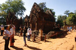 FILE - In this Dec. 23, 2017, file photo, tourists visit Banteay Srey temple outside Siem Reap, Cambodia. Cambodia is closing the Angkor temple complex to visitors because of a growing COVID-19 outbreak. On Thursday, April 8, 2021, the Health Ministry said 113 cases were reported from local transmission, with two deaths. The ministry traced the outbreak to a foreign resident who broke hotel quarantine to visit a nightclub. (AP Photo/Heng Sinith, File)