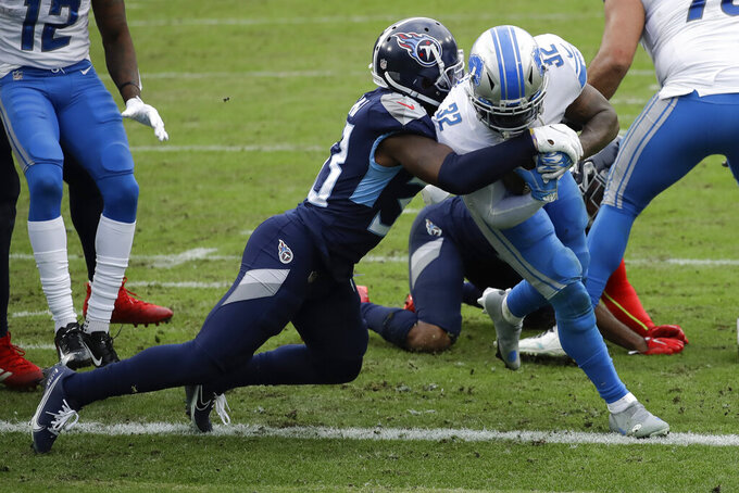Detroit Lions running back D'Andre Swift scores past Tennessee Titans free safety Desmond King during the first half of an NFL football game Sunday, Dec. 20, 2020, in Nashville, Tenn. (AP Photo/Ben Margot)