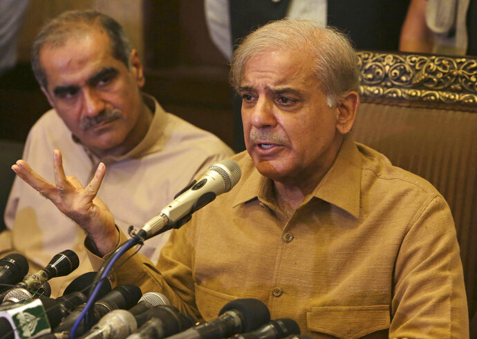 Shahbaz Sharif, brother of Pakistan's former prime minister Nawaz Sharif, who now heads the Pakistan Muslim League, addresses a news conference in Lahore, Pakistan, Thursday, July 12, 2018. Shahbaz Sharif condemned the arrests of their supporters, demanded they stop and that everyone detained be immediately released. He told reporters in Lahore that he plans to be at