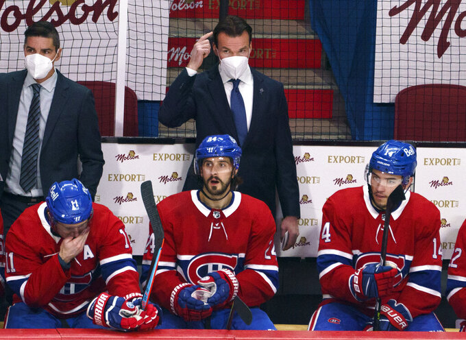 Montreal Canadiens substitute coach Luke Richardson stands behind the team bench during the first period of Game 3 of the team's NHL hockey semifinal series against the Vegas Golden Knights, Friday, June 18, 2021, in Montreal. (Paul Chiasson/The Canadian Press via AP)
