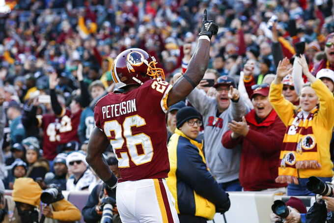 Washington Redskins running back Adrian Peterson (26) celebrates his touchdown in the second half of an NFL football game against the Philadelphia Eagles, Sunday, Dec. 15, 2019, in Landover, Md. (AP Photo/Alex Brandon)