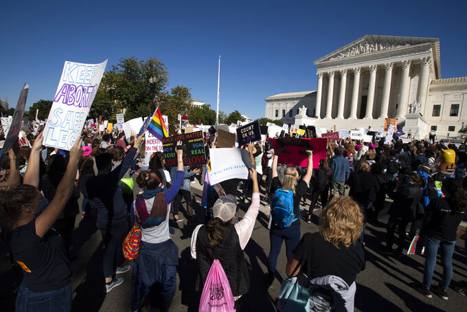 EDS NOTE: OBSCENITY - Demonstrators rally at the Supreme Court, during the Women's March in Washington, Saturday, Oct. 17, 2020. (AP Photo/Jose Luis Magana)