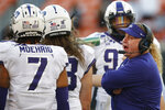 TCU head coach Gary Patterson talks to his team in the second half of an NCAA college football game against Oklahoma State in Stillwater, Okla., Saturday, Nov. 2, 2019. (AP Photo/Sue Ogrocki)