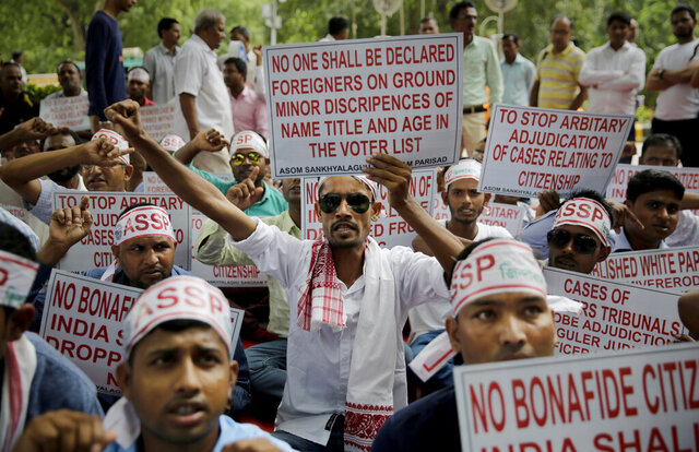 In this Saturday, Aug. 4, 2018, file photo, activists shout slogans during a protest in front of Assam House against the final draft of the National Register of Citizens (NRC) in the northeastern state of Assam, in New Delhi, India. India has been embroiled in protests since December, when Parliament passed a bill amending the country's citizenship law. (AP Photo/Altaf Qadri, File)