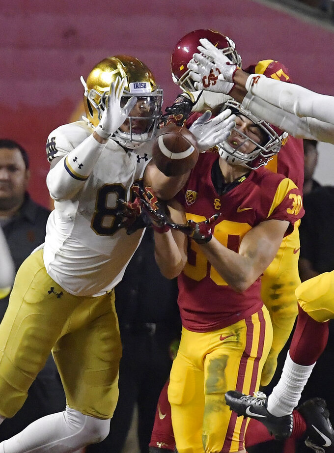 Southern California safety Jordan McMillan, right, intercepts a pass intended for Notre Dame tight end Alize Mack during the second half of an NCAA college football game Saturday, Nov. 24, 2018, in Los Angeles. Notre Dame won 24-17. (AP Photo/Mark J. Terrill)