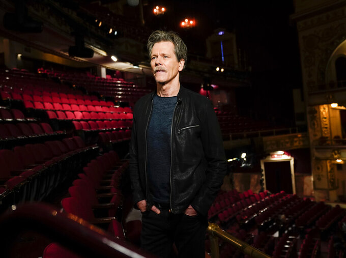 """This image released by CBS shows Kevin Bacon, who will co-host and executive produce """"Play On: Celebrating The Power of Music to Make Change"""" a one-hour benefit concert special to raise funds for the NAACP Legal Defense and Educational Fund, Inc. (LDF) and WhyHunger. The special will be broadcast on Tuesday, Dec. 15 on CBS. (Michele Crowe/CBS via AP)"""