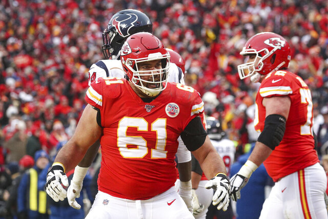 Kansas City Chiefs offensive guard Stefen Wisniewski (61) celebrates a touchdown in an NFL divisional playoff game against the Houston Texans, Sunday, Jan. 12, 2020 in Kansas City. The Chiefs defeated the Texans 51-31 (Margaret Bowles via AP)